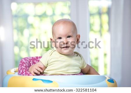 baby in the baby walker - stock photo