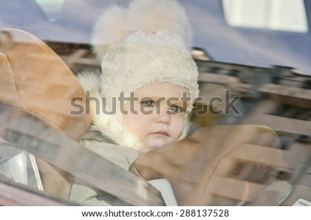 baby in the car in car seat in winter time - stock photo