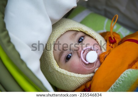Baby in the pram/baby in the carriage - stock photo