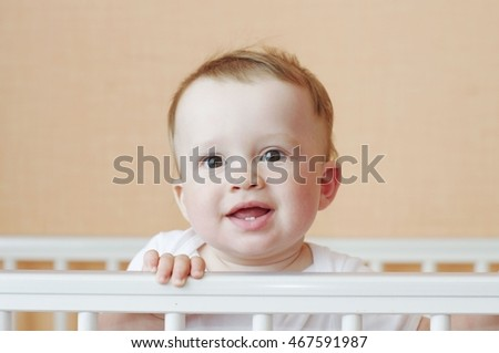 baby in white bed