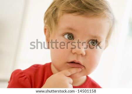 Baby indoors thinking - stock photo
