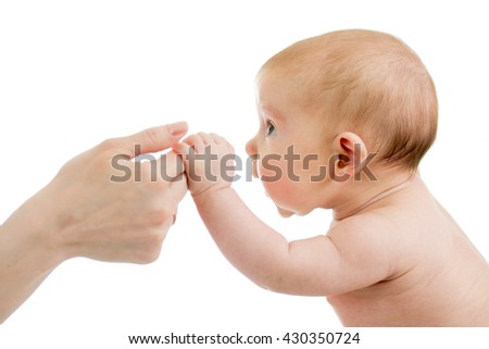 Baby infant holds mother's hand isolated - stock photo