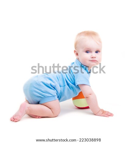 baby is playing with ball. Isolated on white