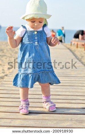 baby is trying to walk  - stock photo