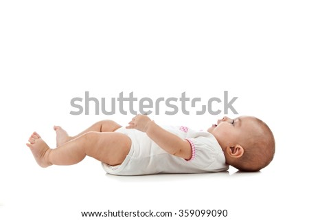 Baby isolated on white background lying on his back