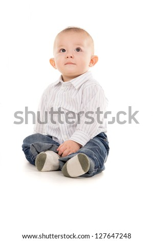 baby just sits on the floor isolated on white background - stock photo