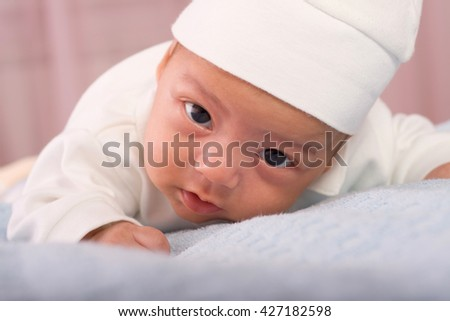 Baby kid on the mild surface closeup portrait