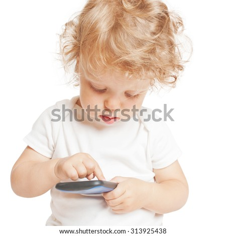Baby kid using smartphone. Isolated on white background - stock photo