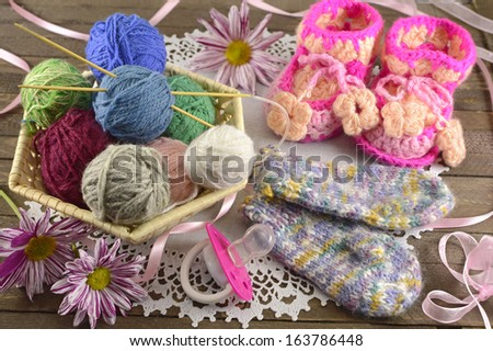 Baby knitting things still life - stock photo