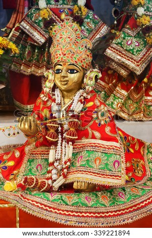 Baby Krishna in Hindu Temple. One of the most popular childhood pranks of Krishna is stealing butter from the house of Gopikaas. Lord Krishna was indeed the great guru of how to live life on earth. - stock photo
