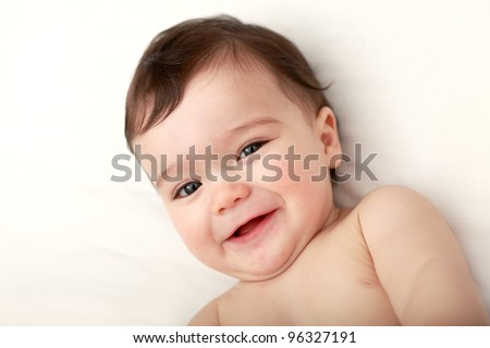 Baby laughing to camera