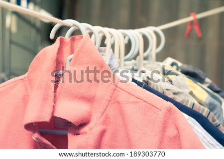 Baby laundry hanging on a clothesline - stock photo