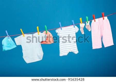 Baby laundry hanging on the rope - stock photo