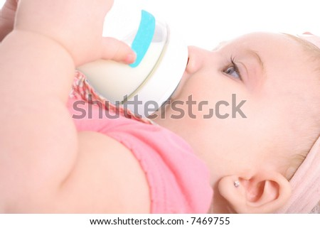 baby laying down drinking bottle - stock photo