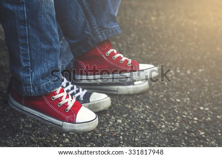 Baby legs in red shoes. - stock photo