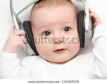 baby listening music on back - stock photo