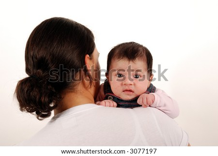 baby looking over shoulder - stock photo