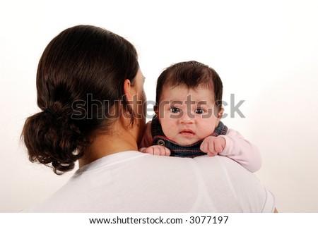 baby looking over shoulder - stock photo