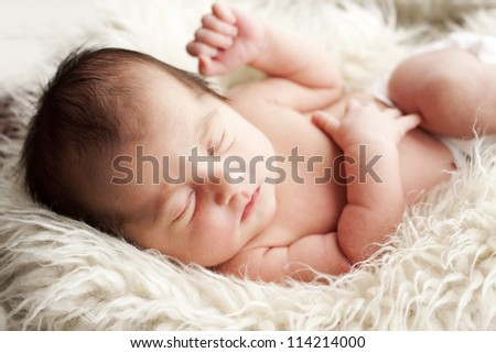 Baby looking right at you. - stock photo