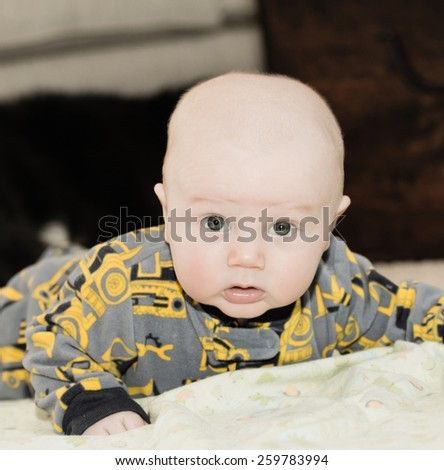 Baby looks around during timmy time! - stock photo