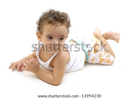 Baby lying down on white background .