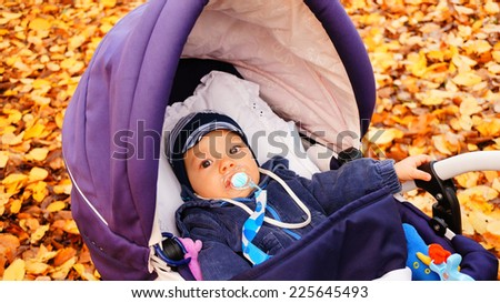 Baby lying in a buggy