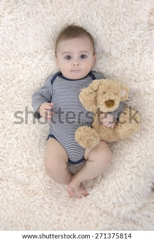 baby lying on his back - stock photo
