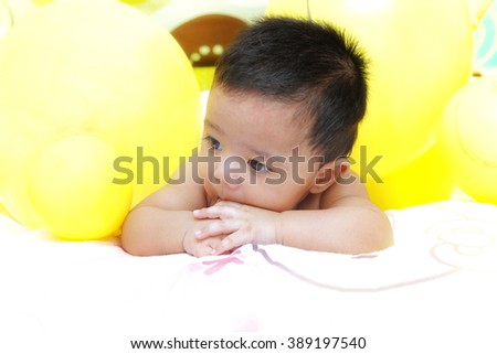 Baby lying on the bed