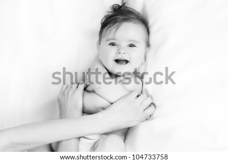 baby Massage - stock photo