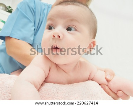 Baby massage doctor massage small caucasian baby boy