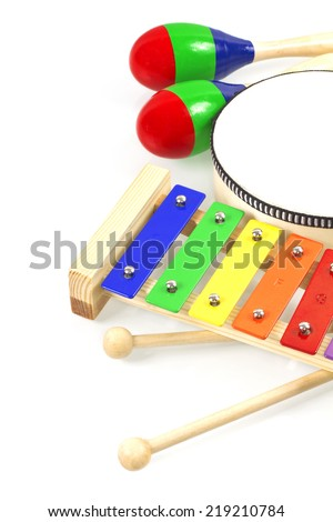 Baby musical instruments collection maracas, xylophone and tambourine isolated on white - stock photo