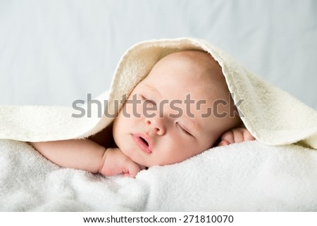 Baby. Newborn Baby Boy Sleeping Peacefully Under Striped Blanket - stock photo