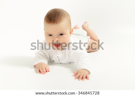 Baby newborn in the shirt closeup isolated on white background.