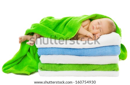 Baby newborn sleeping wrapped in bath towels over white background - stock photo