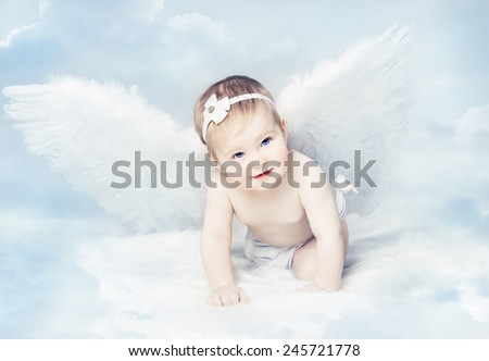Baby Newborn with Angel Wings. Child Sitting at Blue Sky Cloud. Artistic Fantasy Sky Background.  - stock photo
