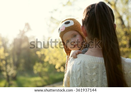 baby on mother's arms - stock photo