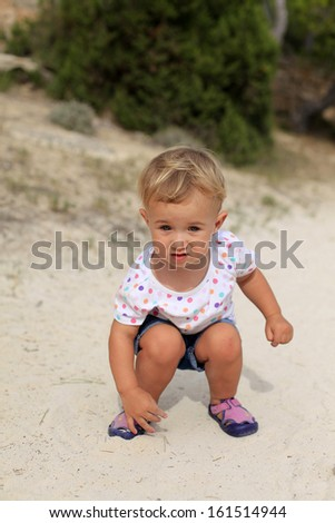 Baby on the beach - stock photo