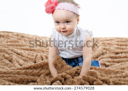 baby on the rug - stock photo