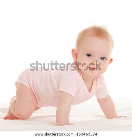 Baby on the white bed - stock photo