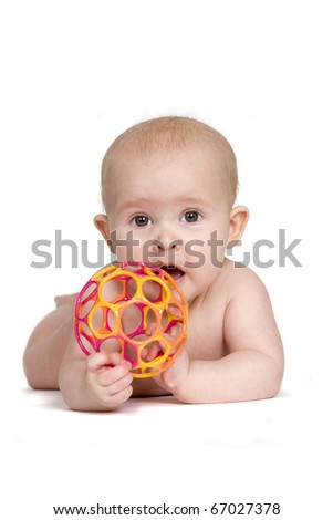 Baby on Tummy Holding Toy