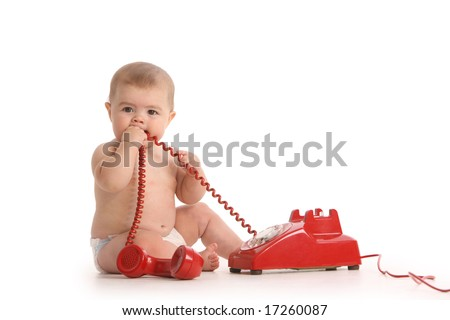 Baby on white background with red telephone - stock photo