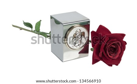 Baby or small child's urn for holding ashes with angel image on the front with Red Rose - path included - stock photo