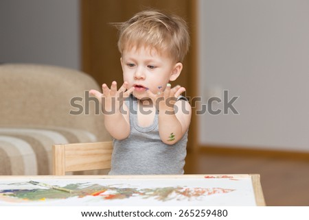 Baby painting. - stock photo