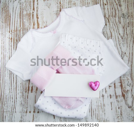 baby  pink apparel with blank greeting card
