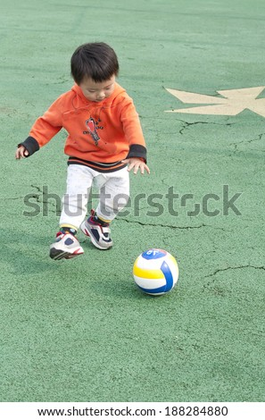 baby play in a children's playground - stock photo