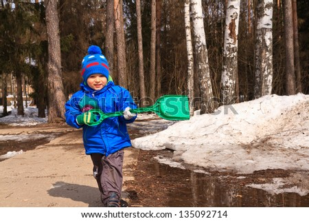baby playing in spring mud - stock photo