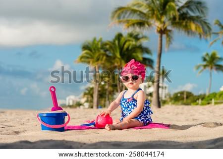 Baby Playing on Beach - stock photo