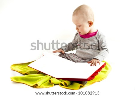 baby playing on green blanket