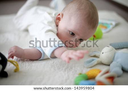 Baby playing toys - stock photo