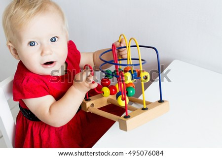 Baby Playing with a Developing Toy. Copy Space